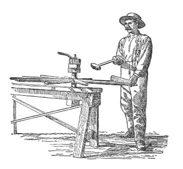 Man Putting in Wooden Wagon Spokes